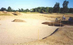 sand being laid over the gravel at Purgatory Golf